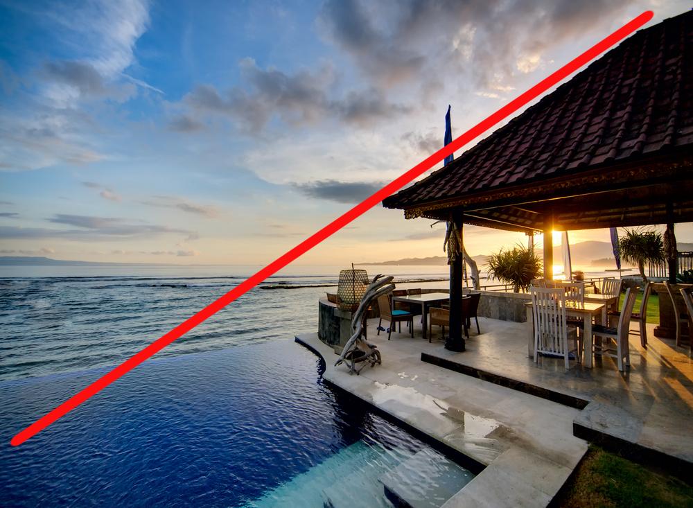 Sunset over Balinese coastline by liseykina