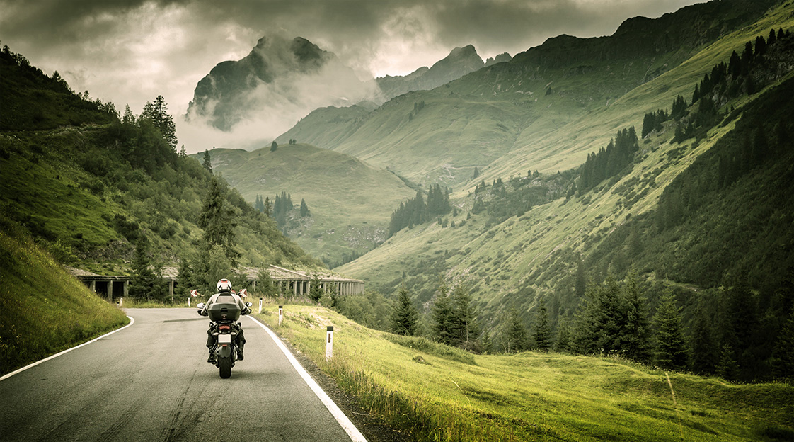 Motorcyclist on mountainous highway by Anna Omelchenko